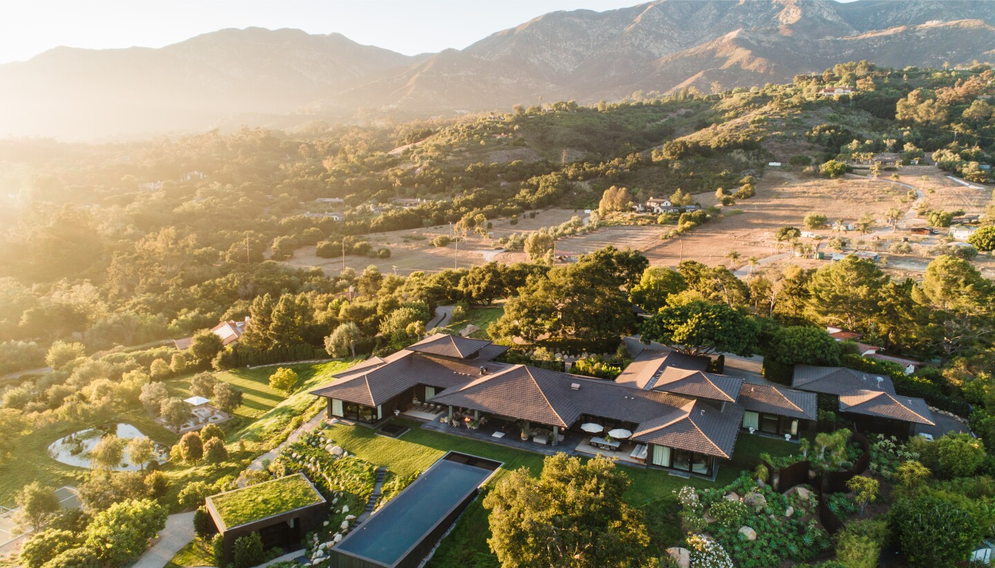 Sprawling across nine acres, the Bali-inspired estate holds a stylish main house, spacious guesthouse, cabana, pool, pond and pickleball court.