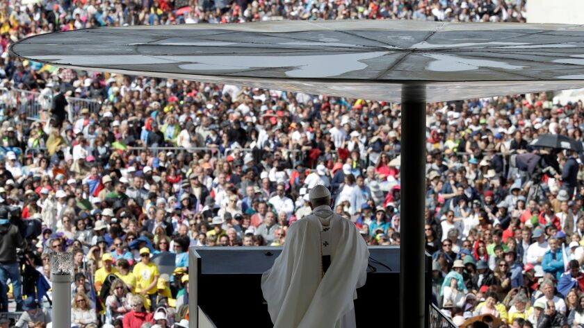 Pope Francis delivers his homily during a mass at the Sanctuary of Our Lady of Fatima Saturday, May