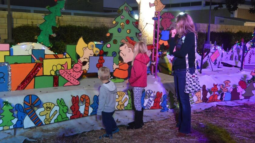 Families took in the Snoopy House Holiday Displays at the Costa Mesa Civic Center lawn on Saturday n
