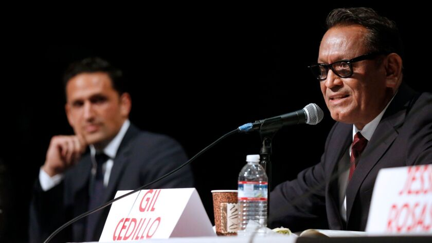 City Council rivals Joe Bray-Ali, left, and Gil Cedillo at a forum last month. Cedillo may have narrowly avoided a runoff, but many provisional and late mail ballots remain to be counted.