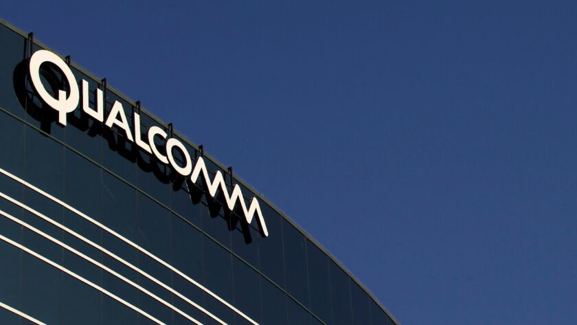 FILE - In this Nov. 2, 2011, file photo, a sign sits atop the Qualcomm headquarters building in San