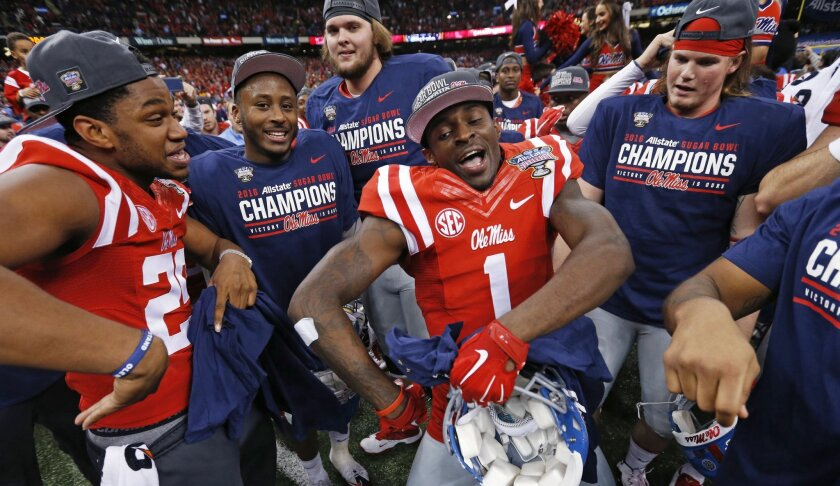 Mississippi wide receiver Laquon Treadwell (1) celebrates after their victory over Oklahoma State in the Sugar Bowl college football game in New Orleans, Friday, Jan. 1, 2016. Mississippi won 48-20. (AP Photo/Jonathan Bachman)