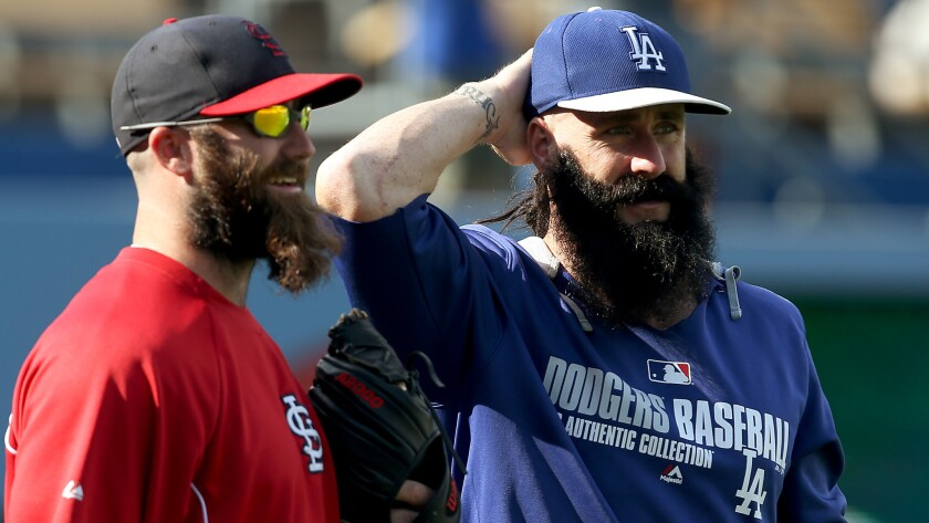 St. Louis Cardinals reliever Jason Motte, left, and Dodgers reliever Brian Wilson talk before a June 26 game at Dodger Stadium.