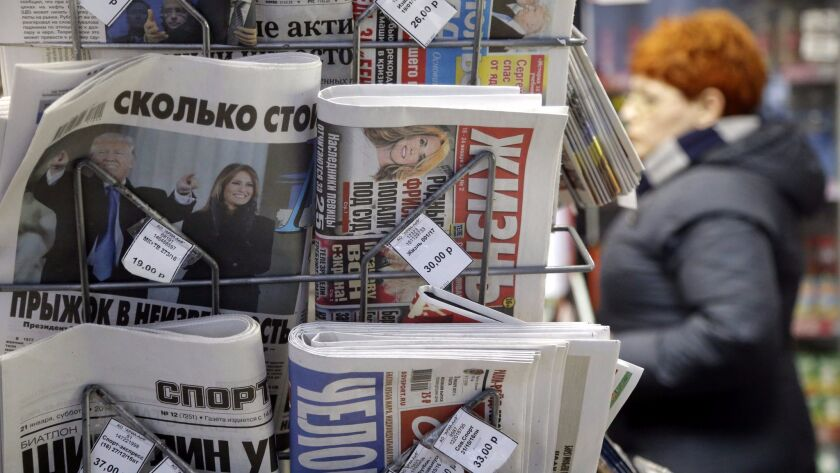 A newsstand at a Moscow railway station displays the newspaper Moskovskij Komsomolets on Jan. 22, with a front page photo of President Trump's inauguration.