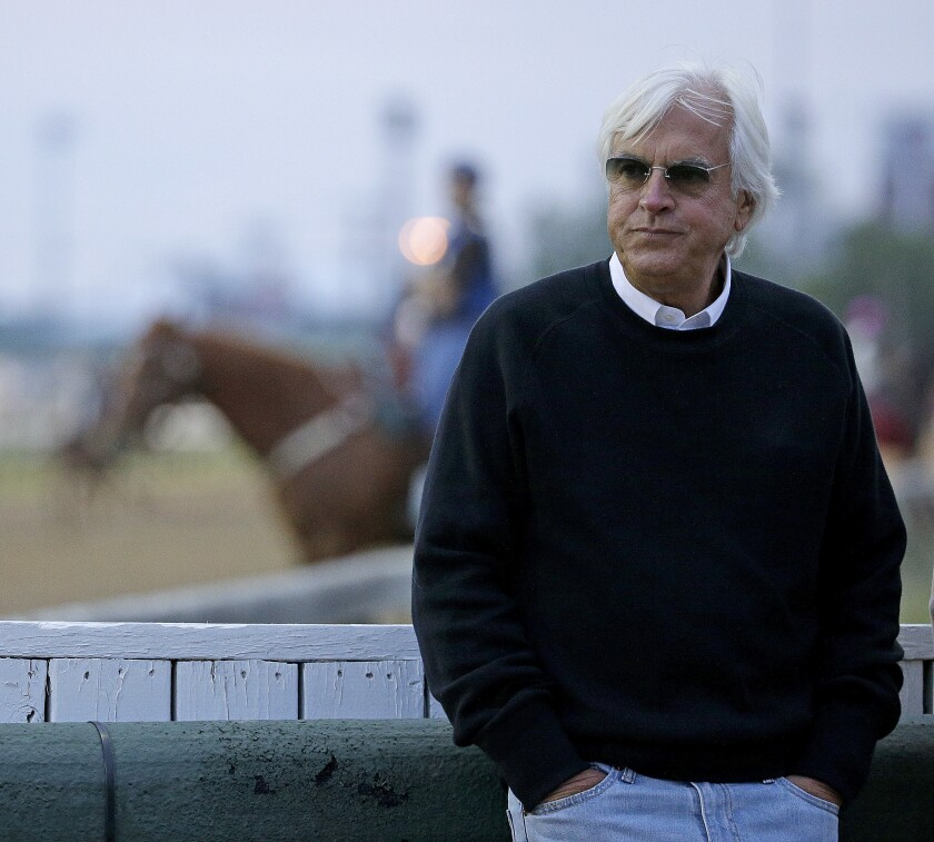 Trainer Bob Baffert watches a workout in 2016 at Churchill Downs in Louisville, Ky.