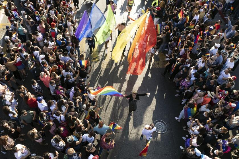 People take part in the LGBTQI+ Pride Parade in Tijuana, Baja California state, Mexico on June 19, 2021.