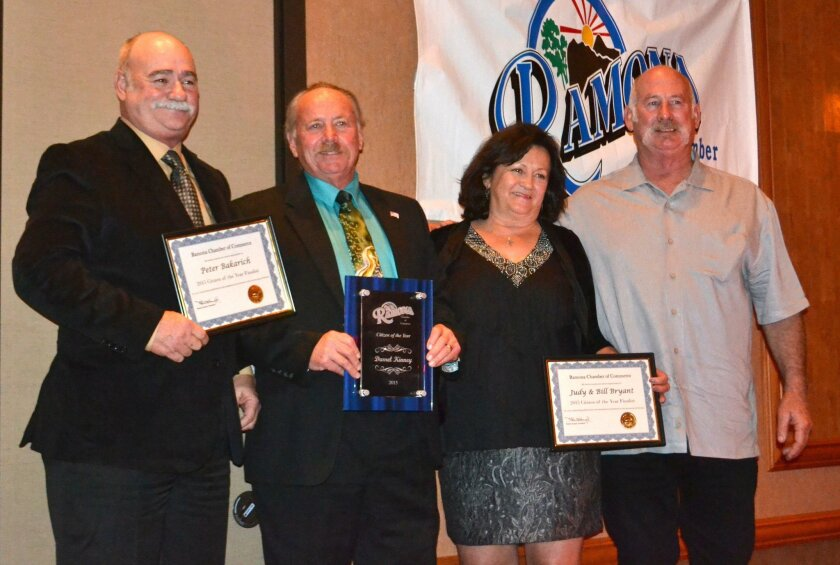 Darrel Kinney, second from left, holds his award for Citizen of the Year, flanked by fellow nominees Pete Bakarich, left, and Judy and Bill Bryant.
