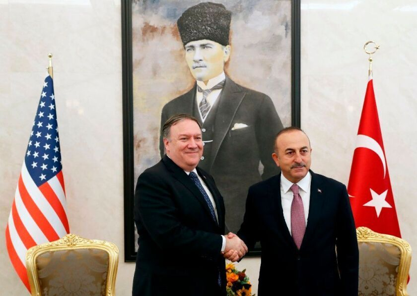 U.S. Secretary of State Mike Pompeo (L) meets with Turkish Foreign Minister Mevlut Cavusoglu in Ankara.