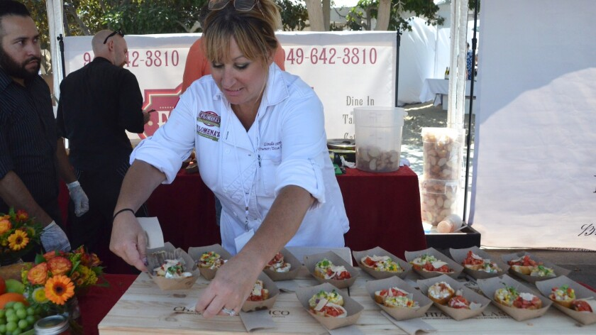 Executive Chef, Linda Johnsen of Filomena's Italian Kitchen arranges three different kinds of Brusch