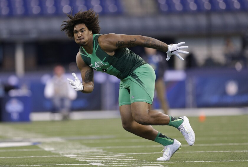 Defensive lineman Leonard Williams performs a drill at the NFL football scouting combine in Indianapolis on Feb. 22.