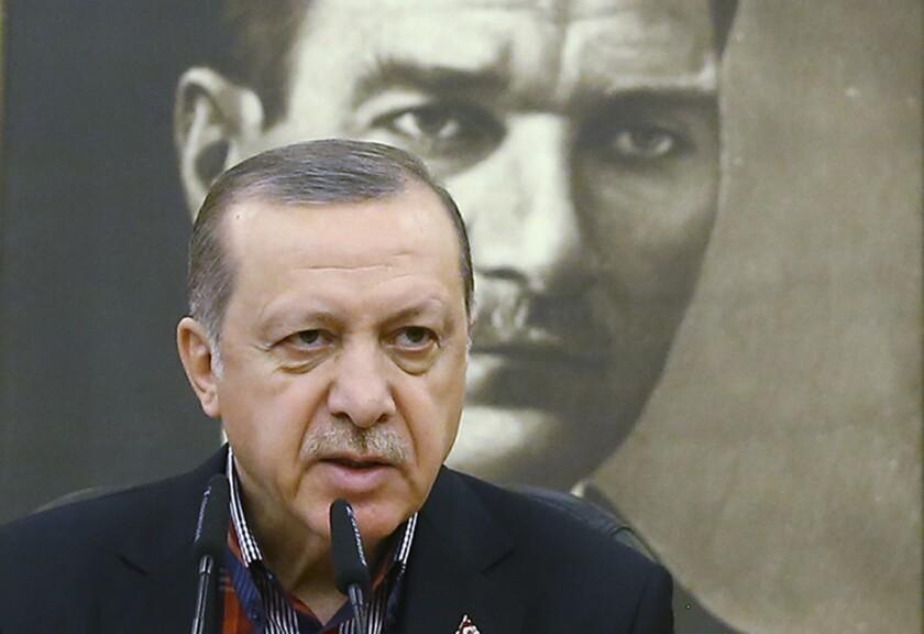 Turkish President Recep Tayyip Erdogan, shown before a portrait of Turkey's founding father, Kemal Ataturk.