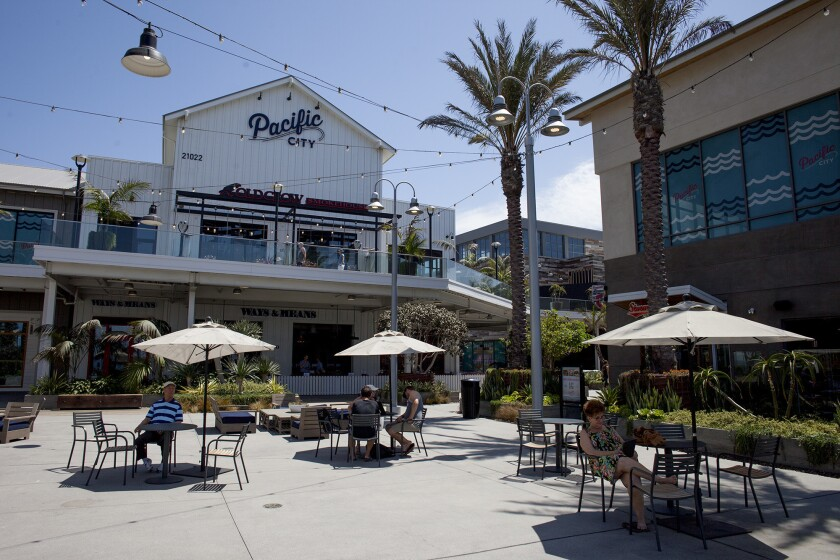 Diners sit outdoors at Pacific City restaurants in Huntington Beach in 2016.