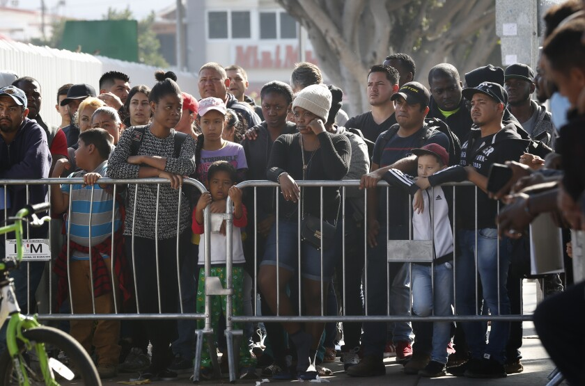 Waiting early Tuesday morning in Tijuana at the Mexico - U.S. border, hundreds listen as a few numbers are called to go to the U.S. border to meet with U.S. immigration officials. Under the new Trump administration rule, which took effect Tuesday, migrants arriving at U.S. territory on the southwest border would be ineligible to apply for asylum if they had failed to file for safe haven in another country en route to the United States.