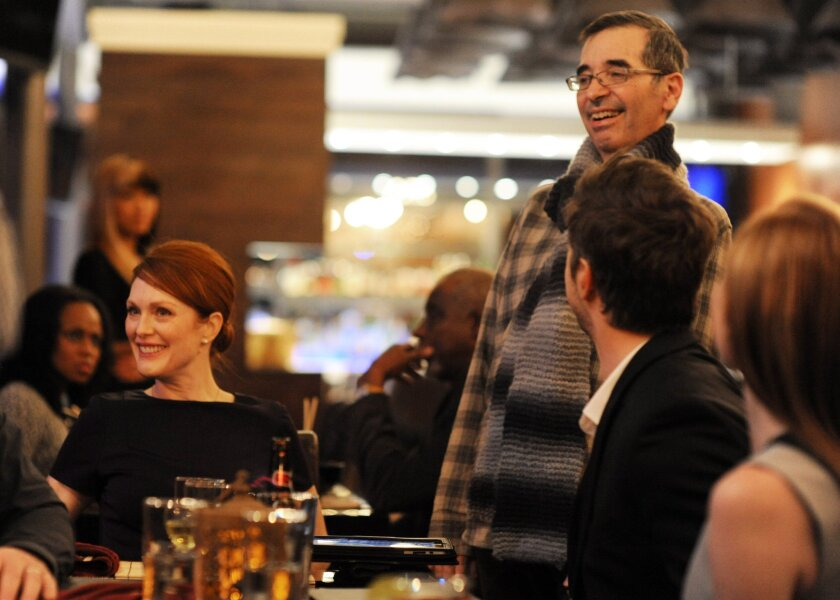 """Actress Julianne Moore, left, and director Richard Glatzer appear on the set during the filming of """"Still Alice."""""""