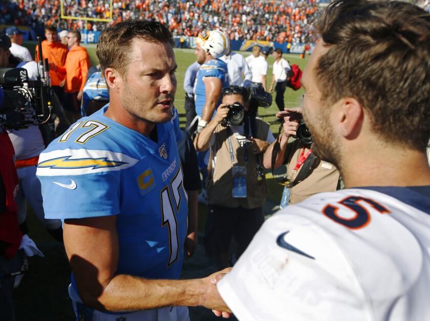 Chargers quarterback Philip Rivers congratulates Denver Broncos quarterback Joe Flacco after the Broncos' 20-13 win on Sunday.