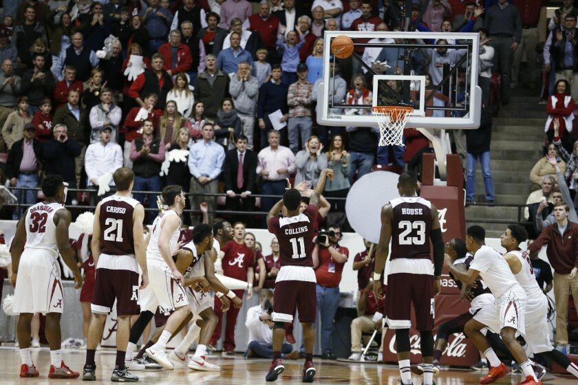 Texas A&M guard Anthony Collins (11) misses the second of his two foul shots against Alabama in the final seconds of an NCAA college basketball game Wednesday, Feb. 10, 2016, in Tuscaloosa, Ala. Alabama won 63-62. (AP Photo/Brynn Anderson)