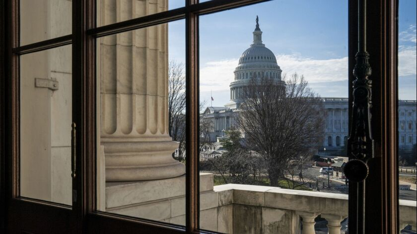 FILE- This Dec. 27, 2018, file photo shows the Capitol Dome from the Russell Senate Office Building