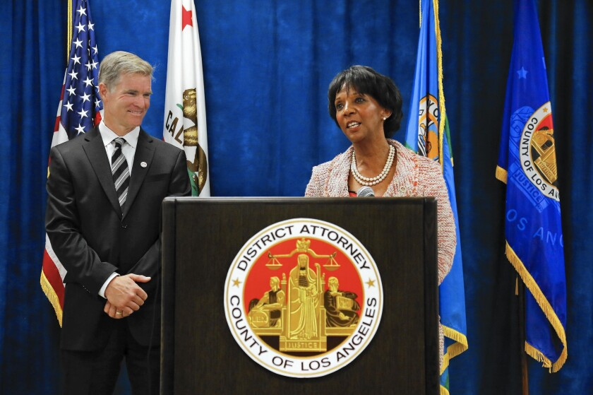 Dist. Atty. Jackie Lacey announces the creation of the Conviction Review Unit, to be headed by Ken Lynch, left.