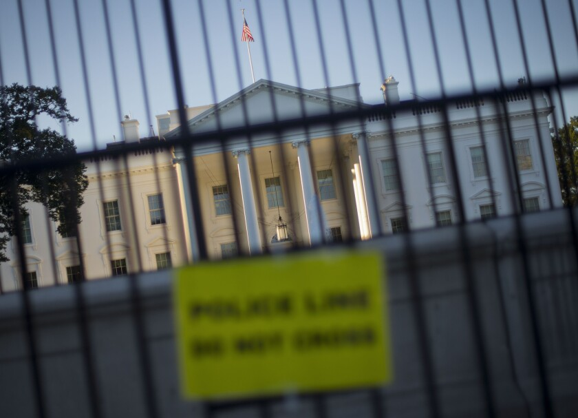 A perimeter fence sits in front of the White House fence along Pennsylvania Avenue in Washington. The Secret Service faces scrutiny anew in the wake of revelations about its fumbled response to shots fired at the White House in 2011.