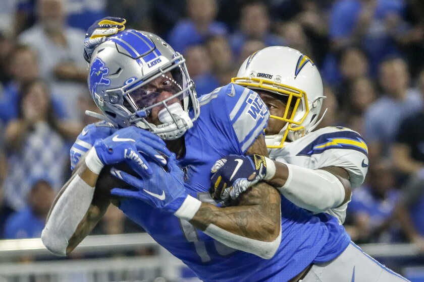 Lions wide receiver Kenny Golladay catches a 31-yard touchdown pass in front of Chargers cornerback Casey Hayward.
