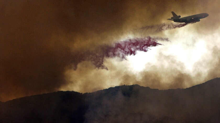 A converted DC-10 jumbo jet drops fire retardant on a brush fire near Corral Canyon in Malibu in November. The plane is part of the California Department of Forestry and Fire Protection fleet of aircraft, which includes two dozen tankers, 11 heavy-duty helicopters and 14 twin-engine command-and-control planes.