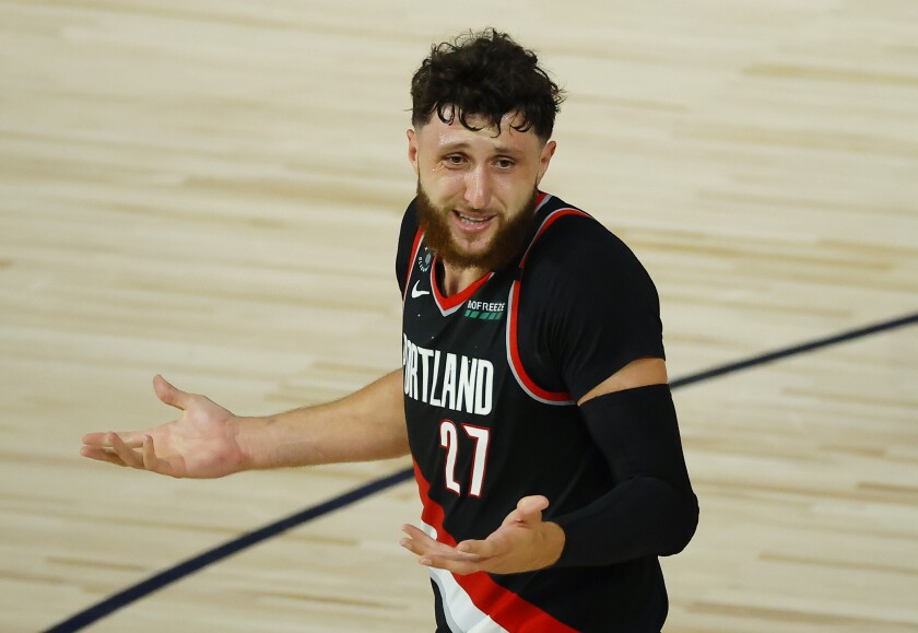The Portland Trail Blazers' Jusuf Nurkic throws up his arms against the Memphis Grizzlies on. Aug. 15, 2020.