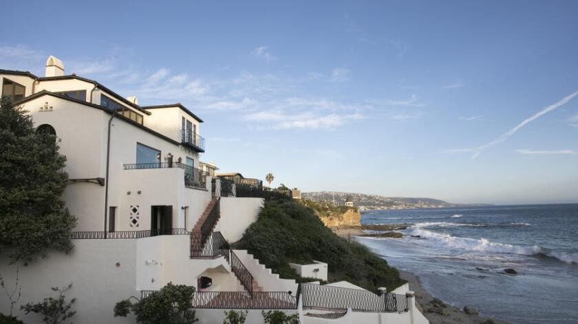 The 1920s Mediterranean Revival-style house sits on a quarter-acre bluff overlooking Shaw's Cove in Laguna Beach.