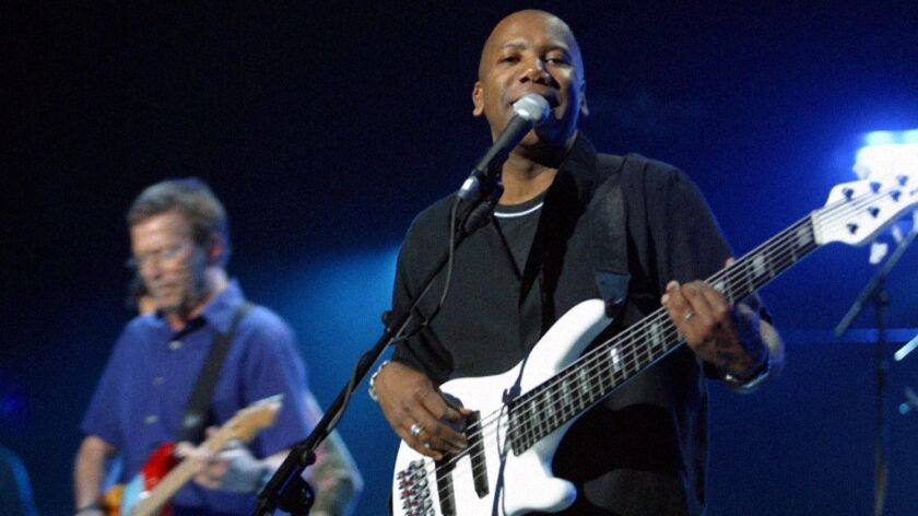 Former San Diegan Nathan East (right) will play a hometown gig at the Imperial Avenue Street Festival Saturday, prior to his New York and Los Angeles concerts with Eric Clapton (right).