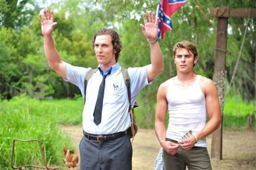 """This film image released by Millennium Films shows Matthew McConaughey, left, and Zac Efron in a scene from """"The Paperboy.""""  (AP Photo/Millennium Films, Anne Marie Fox)"""