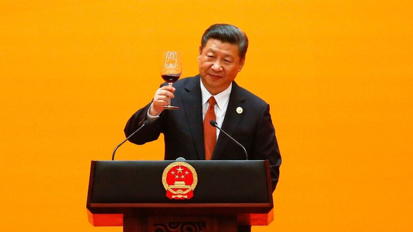 Chinese President Xi Jinping makes a toast at the beginning of the welcoming banquet at the Great Hall of the People during the first day of the Belt and Road Forum in Beijing on May 14, 2017.