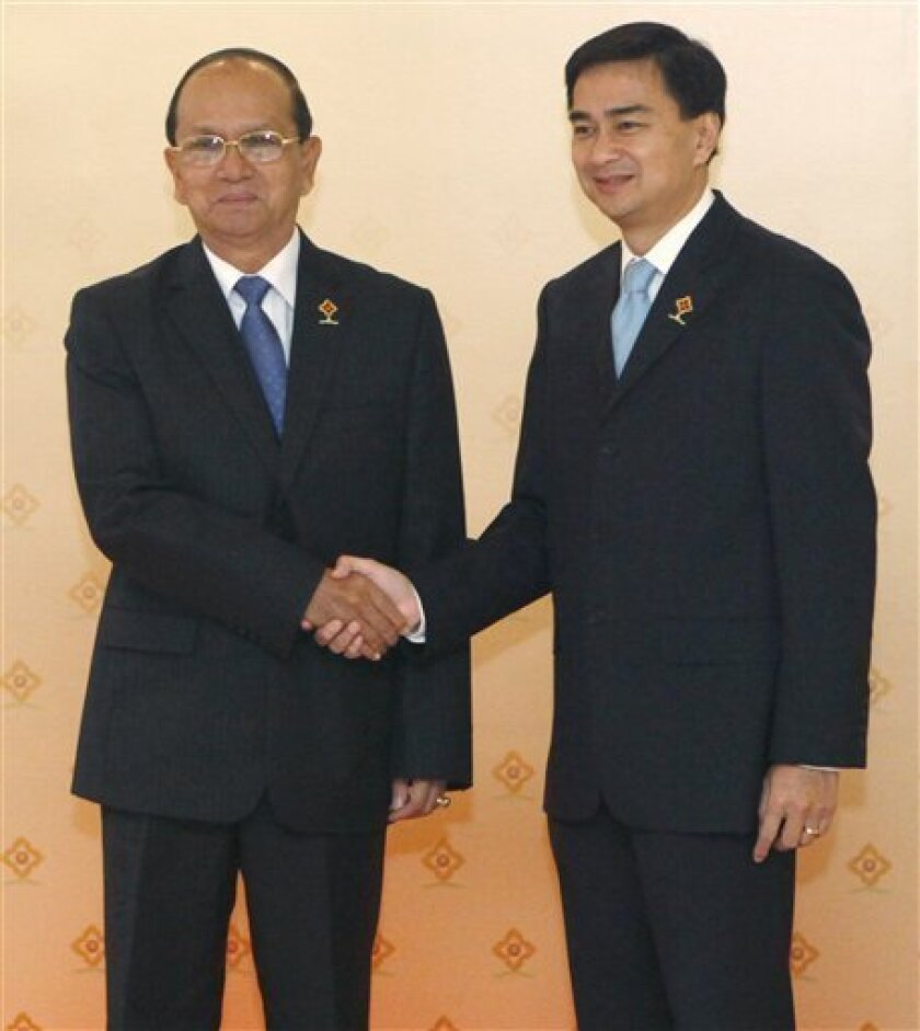 Thailand's Prime Minister Abhisit Vejjajiva, right, poses with Myanmar's Prime Minister General Thein Sein before a meeting of the heads of state during the 14th Association of Southeast Asian Nations (ASEAN) summit inCha-am, about 200 km (125 miles) south of Bangkok, Thailand, Sunday, March 1, 200