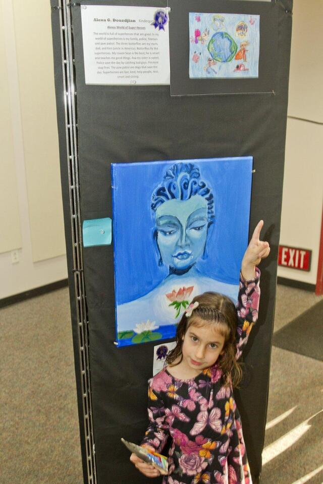 "Kindergartener Alexa Douzdjian with her entry ""Alexa's World of Super Heros"""