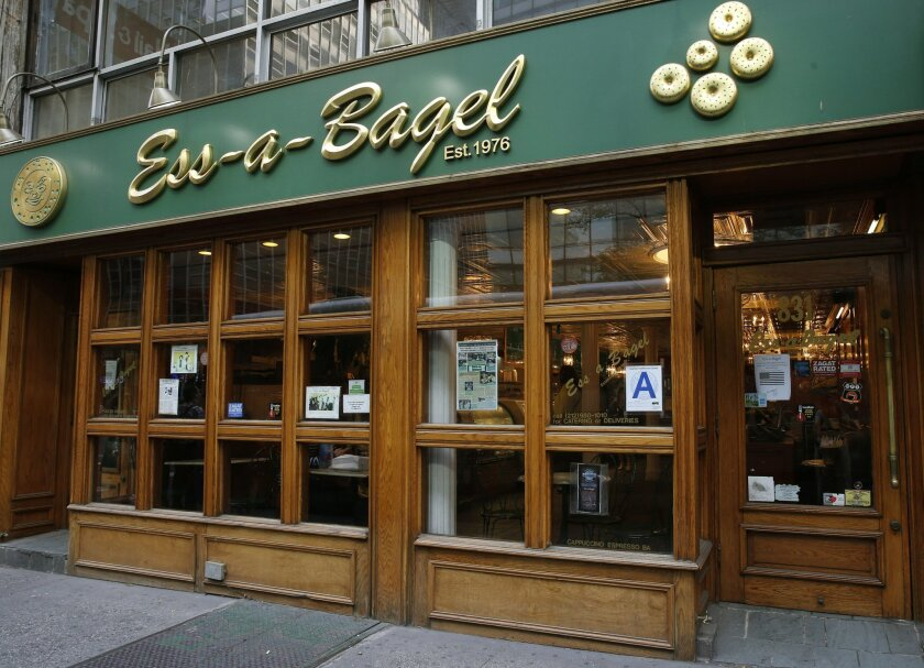 This Thursday, May 26, 2016 photo shows the exterior of Ess-a-Bagel on Third Avenue and 51st Street in New York. The business has been around for nearly 40 years, but has moved to Midtown, though the old shop, located on First Avenue at 1st street, will be reopening near the original location soon,