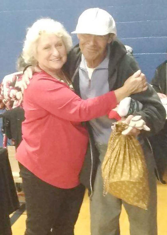 Copy - Ann Isaac gives care kit bag to Gilberto.jpg