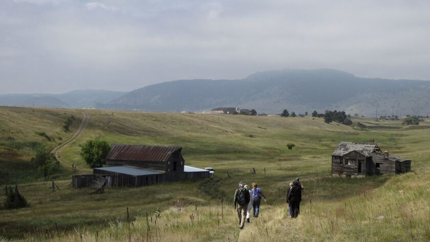 Visitors take a guided hike through the Rocky Flats National Wildlife Refuge near Denver last year.