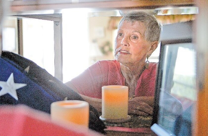 Susanne Ward-Baker created a testament to her son Tim's life, and death,  in a cabinet in her Escondido home, including a photo taken by Tim's girlfriend  Linda Brewton in May 2001.