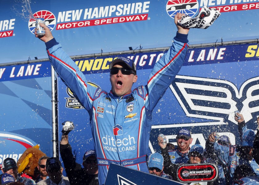 Kevin Harvick celebrates in victory lane after winning the NASCAR Sprint Cup Series race at New Hampshire Motor Speedway.