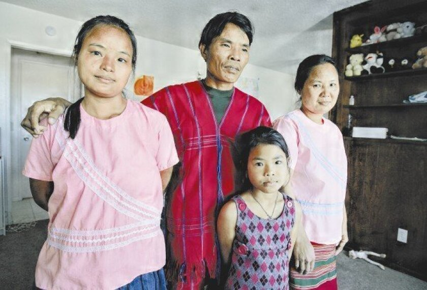 The family of Saw Reh (center) and his wife, Ku Meh (right), escaped from the oppressive regime in their homeland of Myanmar.