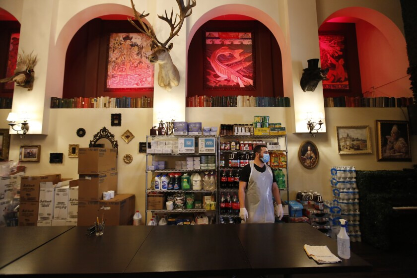 Ike Gazaryan owner of Pushkin Russian Restaurant, in downtown San Diego, has converted an online-only supermarket.
