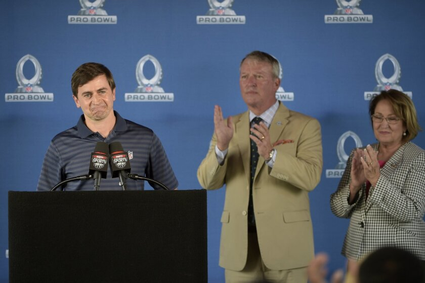 Peter O'Reilly, left, NFL Senior Vice President of Events, announces Orlando, Fla., as the new host for the NFL Pro Bowl football game as Orange County Mayor Teresa Jacobs, right, and Orlando Mayor Buddy Dyer applaud during a news conference in Kissimmee, Fla., Wednesday, June 1, 2016. (AP Photo/Ph