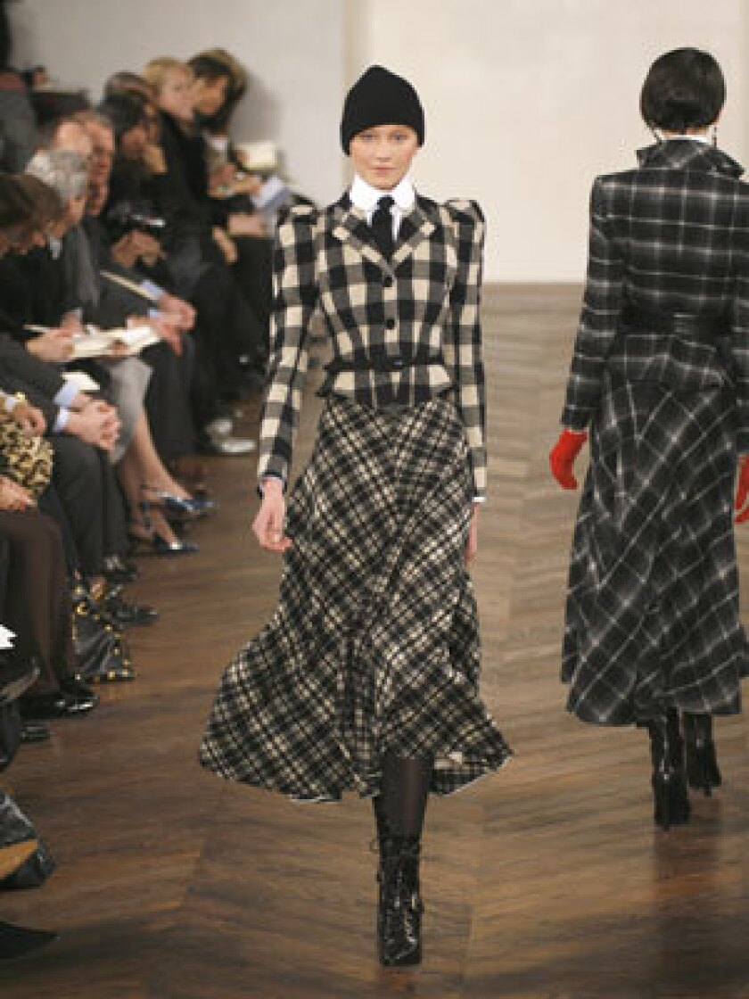 MAD FOR PLAID: A fitted buffalo-check jacket is paired with a long skirt in Ralph Lauren's fall/winter 2009 collection.