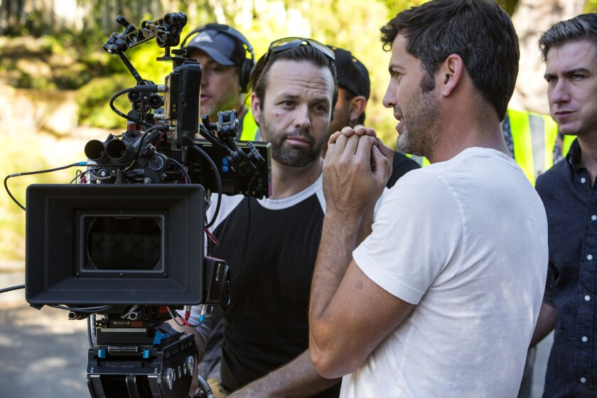 """The law is intended to make California more competitive with rival states such as New York, Georgia and Louisiana. Above, Director David M. Rosenthal, in white, talks strategy with cameraman BJ McDonnell on the set of the movie """"The Perfect Guy"""", in Hollywood."""