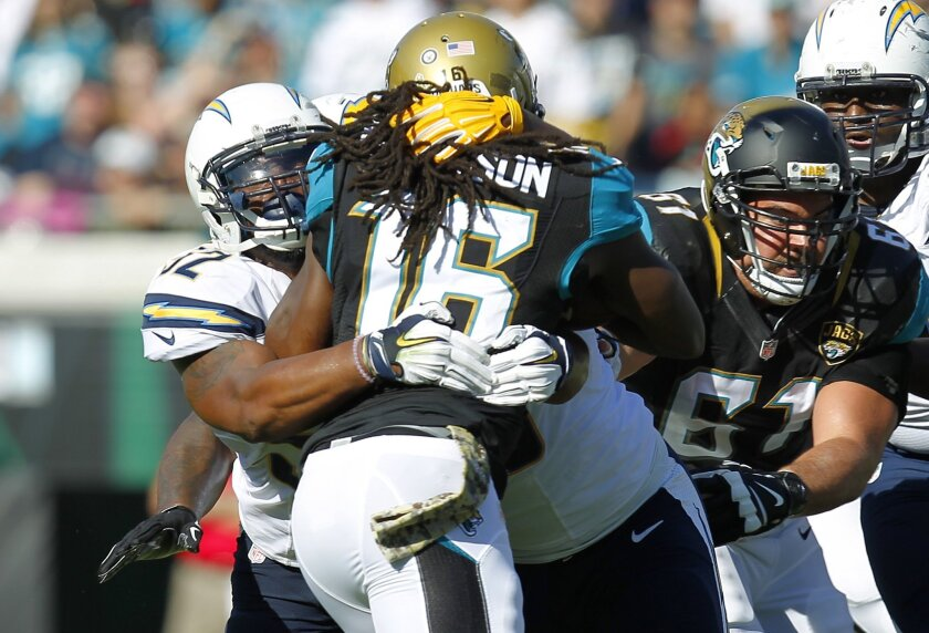 San Diego Chargers Denzel Perryman stops Jacksonville's Denard Robinson in the 2nd quarter.  (K.C. Alfred/ San Diego Union-Tribune)