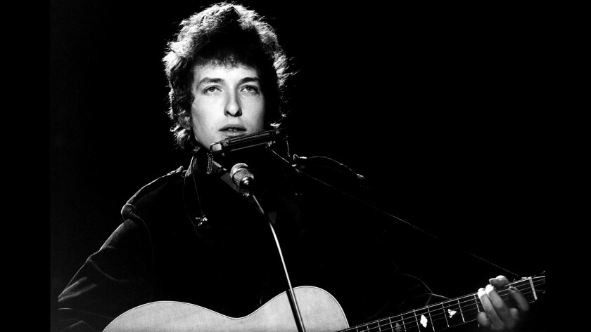 "Bob Dylan performs for BBC television in London in 1965. His working draft of lyrics for his hit ""Like a Rolling Stone"" sold at auction for just over $2 million Tuesday."
