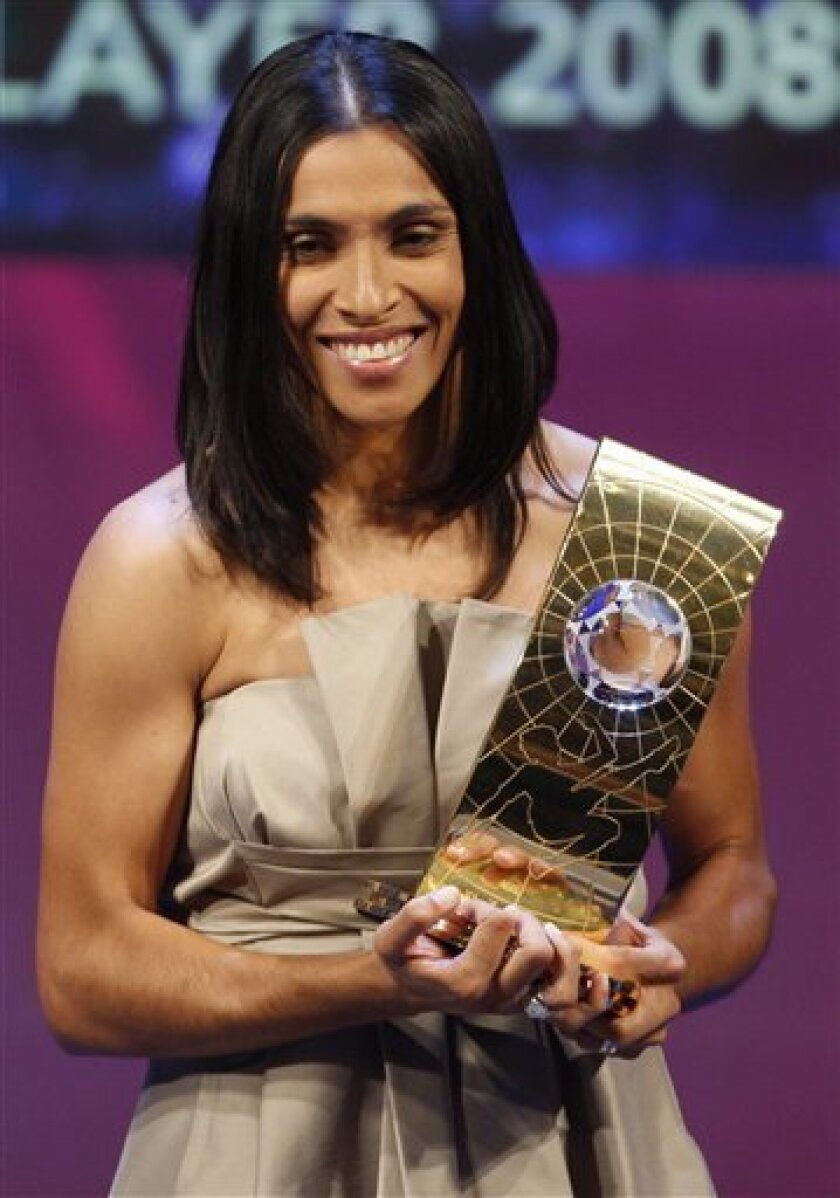 Soccer player Marta from Brazil   poses with the trophy after being named FIFA World Player of the Year during the FIFA World Player Gala 2008 at the Opera house in Zurich, Switzerland, Monday, Jan. 12, 2009. (AP Photo/KEYSTONE/Steffen Schmidt)