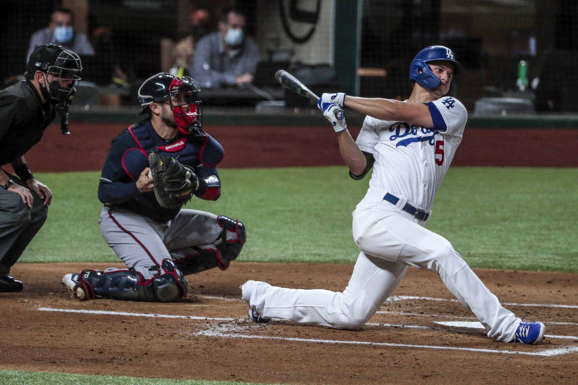 Dodgers shortstop Corey Seager swings at a pitch during Game 1 of the NLCS against the Atlanta Braves on Monday.