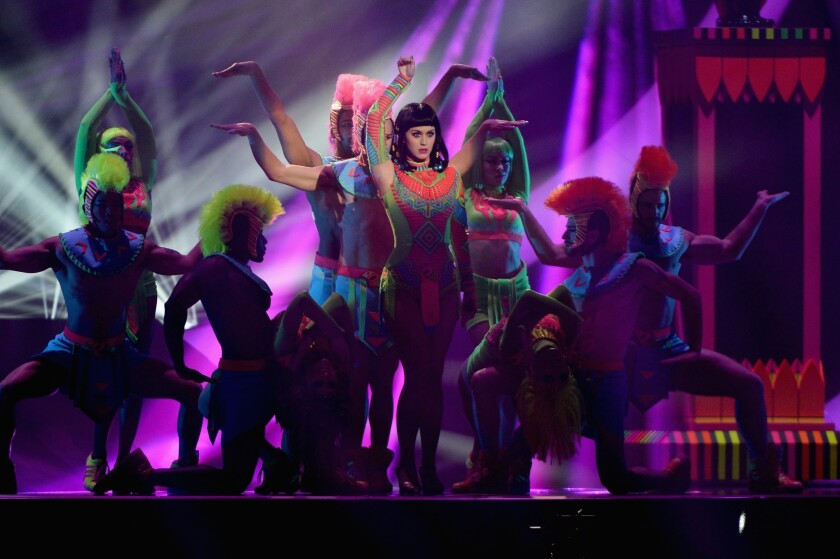 """Singer Katy Perry, shown performing in London for the BRIT Awards on Feb. 19, 2014, has been criticized for an image in her """"Dark Horse"""" video in which a man wearing a pendant with the Arabic word for """"God"""" is disintegrated. The video has been reedited to remove the image."""