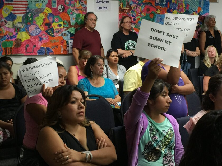 Roughly 150 parents and teachers of Jefferson Middle School and other schools in Oceanside Unified School District showed up to a board of trustees meeting Tuesday to protest a decision to approve a charter school petition that displaces enrollment at several schools in the district.