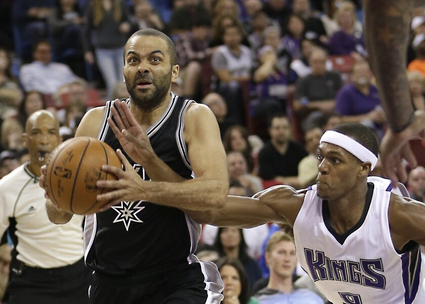 Sacramento Kings guard Rajon Rondo, right, knocks the ball from San Antonio Spurs guard Tony Parker during the first quarter of an NBA basketball game Wednesday, Feb. 24, 2016, in Sacramento, Calif.(AP Photo/Rich Pedroncelli)