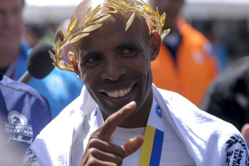 Meb Keflezighi celebrates winning the Boston Marathon on Monday, becoming the first American male to win since 1983.